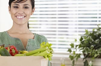 Woman with bag of vegetables