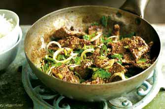 Ching-He Huang's spiced beef stir-fry topped with spring onion and ...