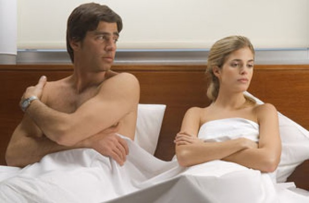 man and woman in bed_photolibrary