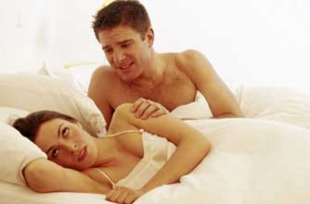 couple in bed_photolibrary