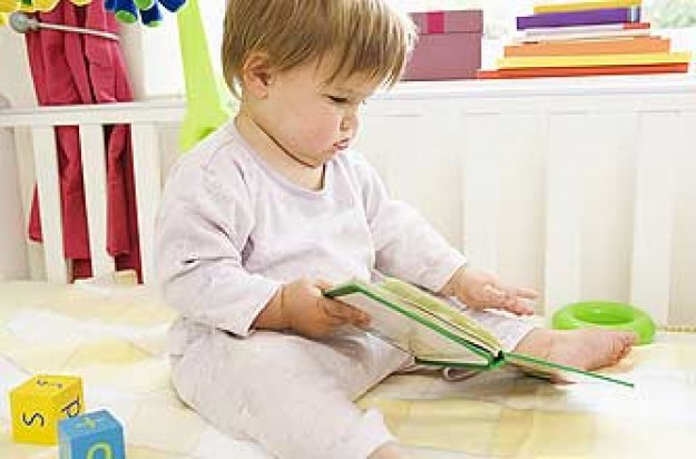 Baby holding book_plibrary