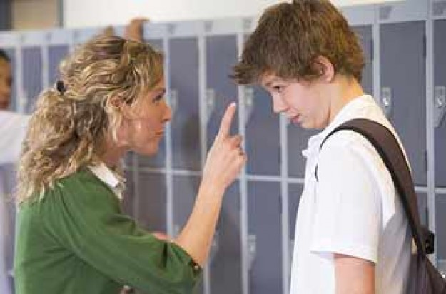 Teenage boy in trouble with teacher_plibrary