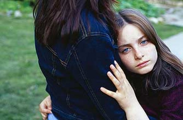 A girl hugging her mum