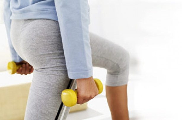 Woman lunging with dumbellls