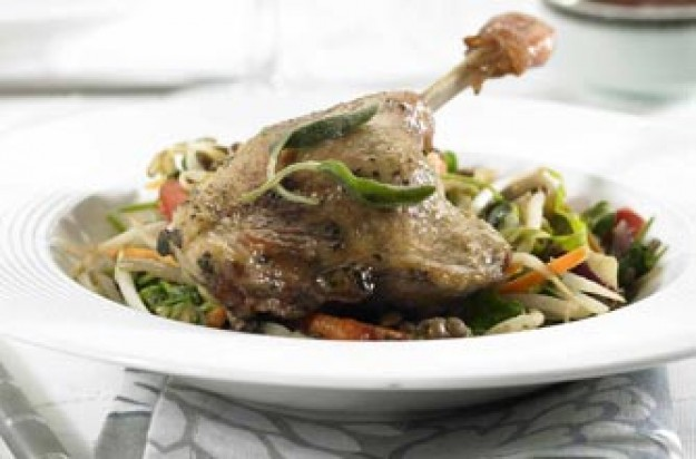 Duck confit with lentils and stir-fry
