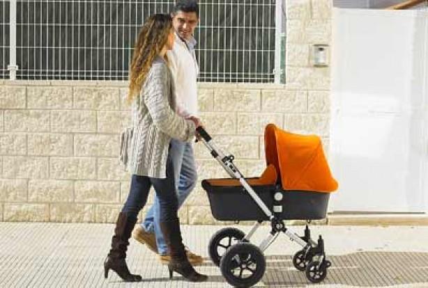 Parents pushing baby in a pram