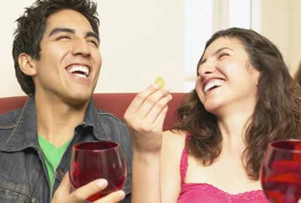 Couple laughing with drink