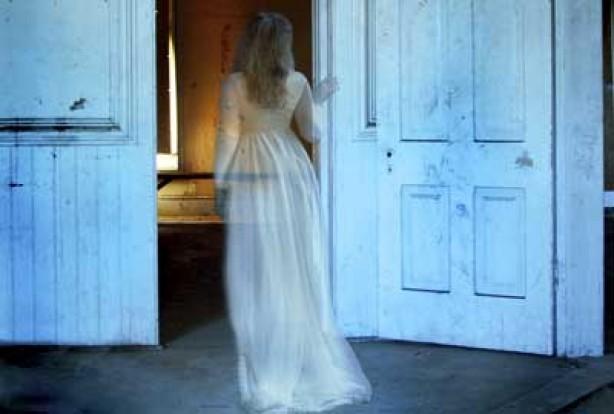 Ghostly woman walking through door