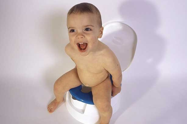 A toddler sitting on the potty