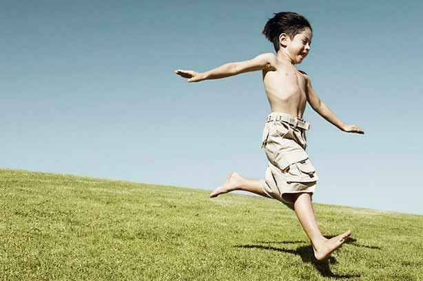 A boy running along on his own