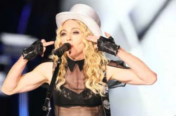Madonna shows off her toned arms on stage