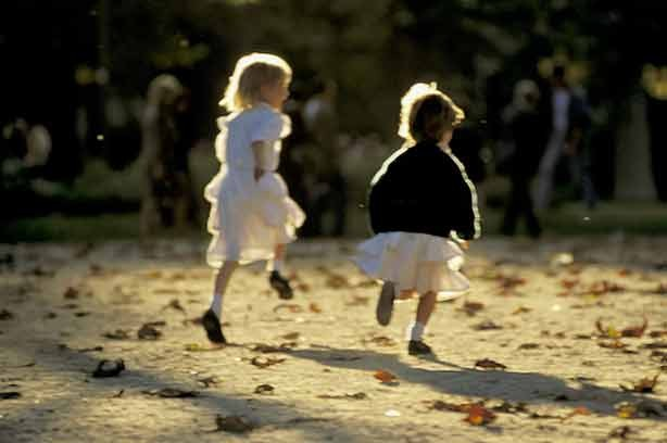 Two children running away