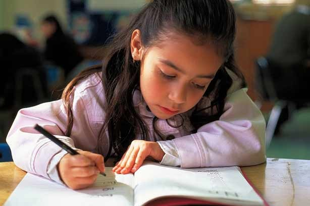 A girl learning how to write