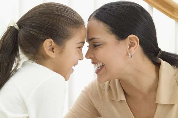 Girl talking to her daughter