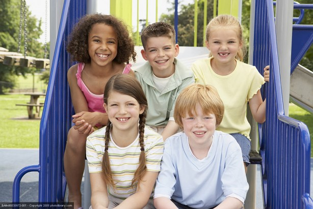 5 friends sitting together in the playground