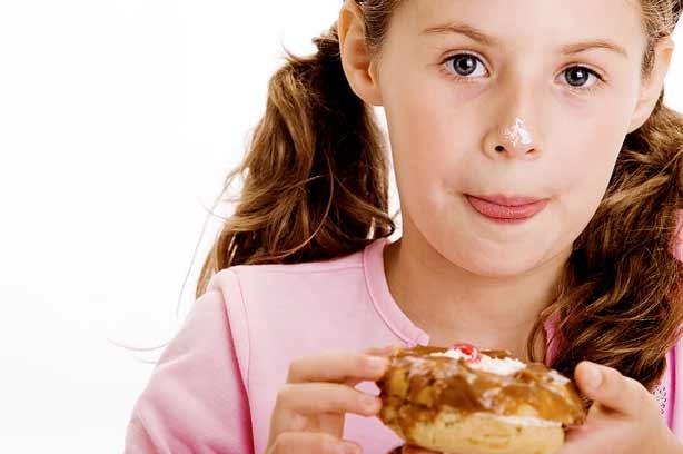 A girl eating pudding