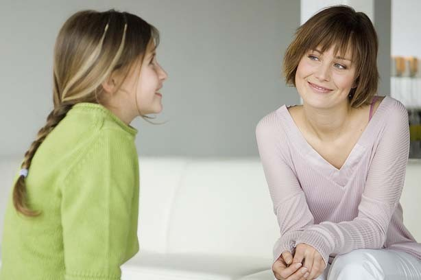 a girl talking with her mum