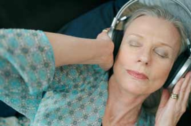 older woman listening to music_Photolibrary