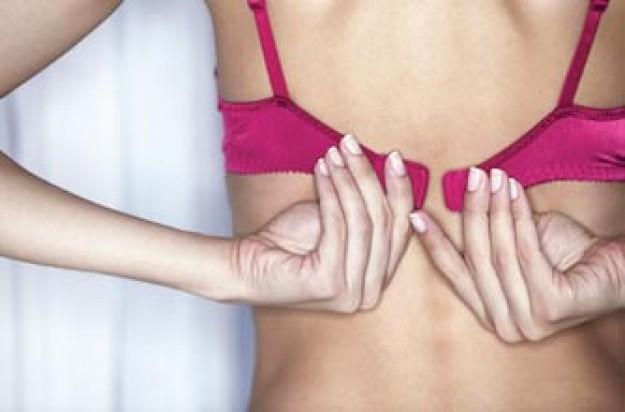 breast-cancer-quiz,-woman-checking-bra_jupiter