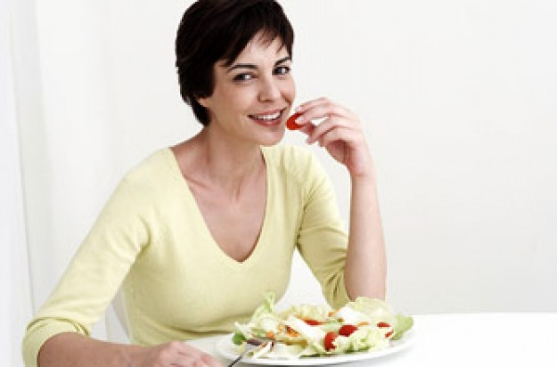 Woman eating salad_Photolibrary