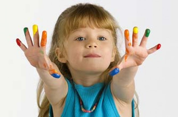 A girl with paint on her fingers