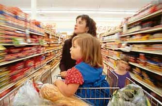 Mum in a supermarket with kids_rex