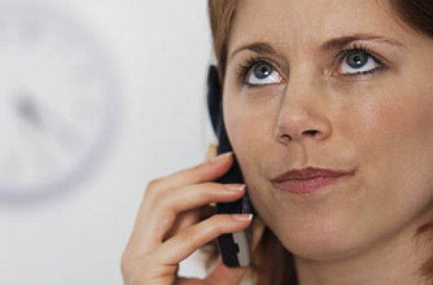 A woman getting annoyed on the phone