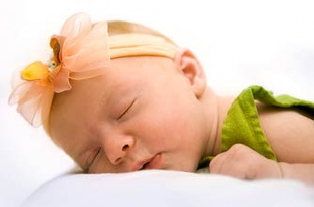 cute baby girl asleep_istock