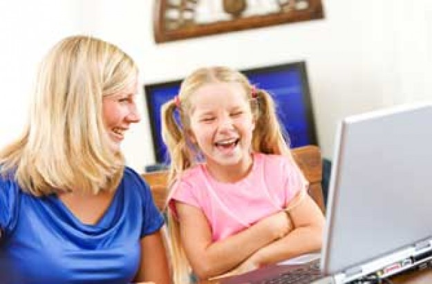 mum and daughter laughing at something online_istock