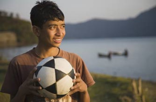 Teenager boy holding a football_Istock