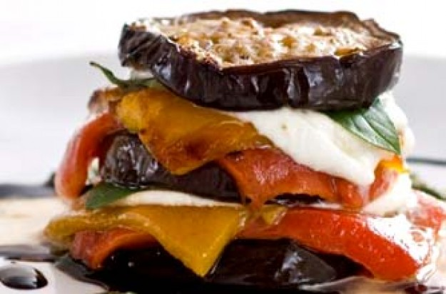 Roasted aubergine, pepper and scarmozza stack pesto and balsamic syrup