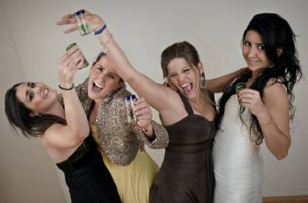 Teenage girls drinking tequila_istock