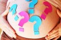Pregnant woman with question marks on belly_istock