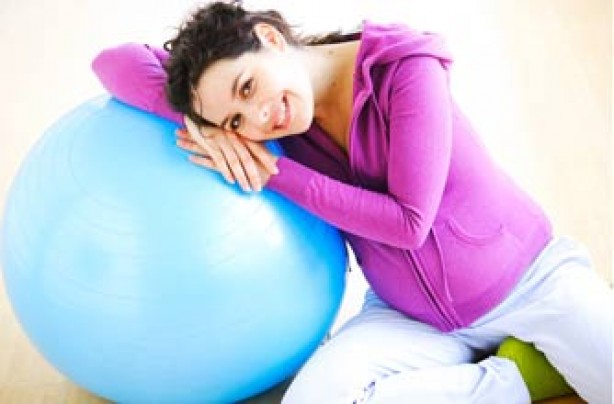 Pregnant woman hugging ball