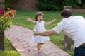 Father greeting his little girl_Istock