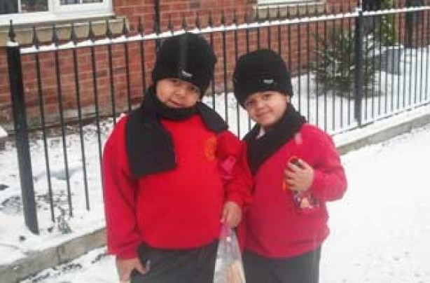 Alex and Mackenzie on their way to school in snowy Manchester