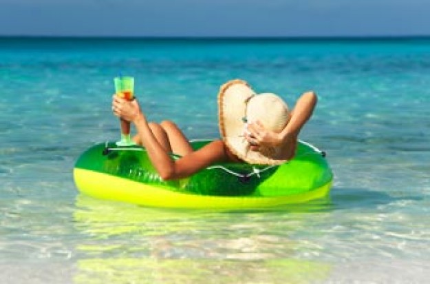 Woman with cocktail in tropical sea