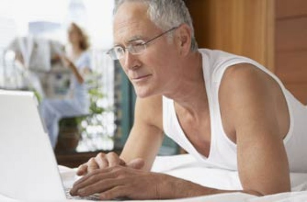 Older man using computer_rex