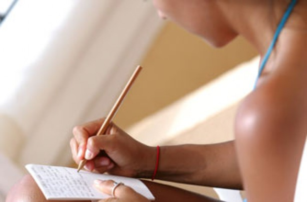 A woman writing a list