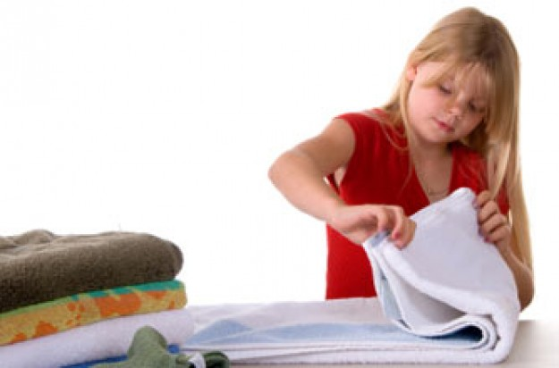 A girl helping with the laundry