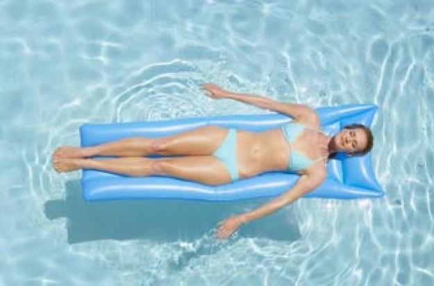 Woman in a pool wearing a bikini