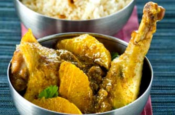 Chicken in curry and orange sauce