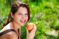 woman eating apple in sun