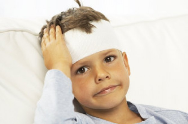 Boy with bandage round his head