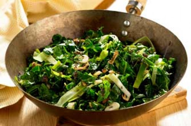 Stir-fried spring greens with garlic and caraway seeds