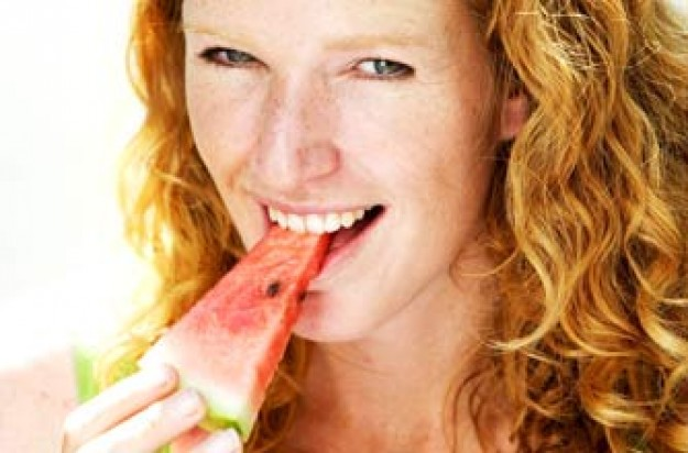Woman eating melon, watermelon