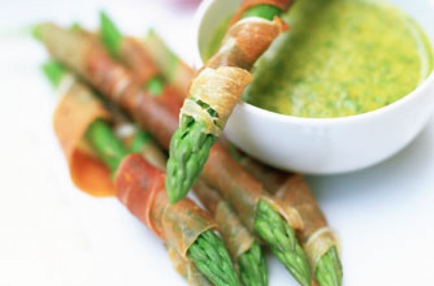 Ham-wrapped asparagus spears with orange honey dip