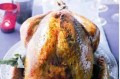 Golden roast turkey with lemon and parsley butter