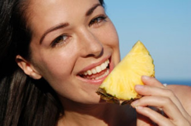 Female eating pineapple