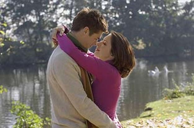 A couple kissing outside
